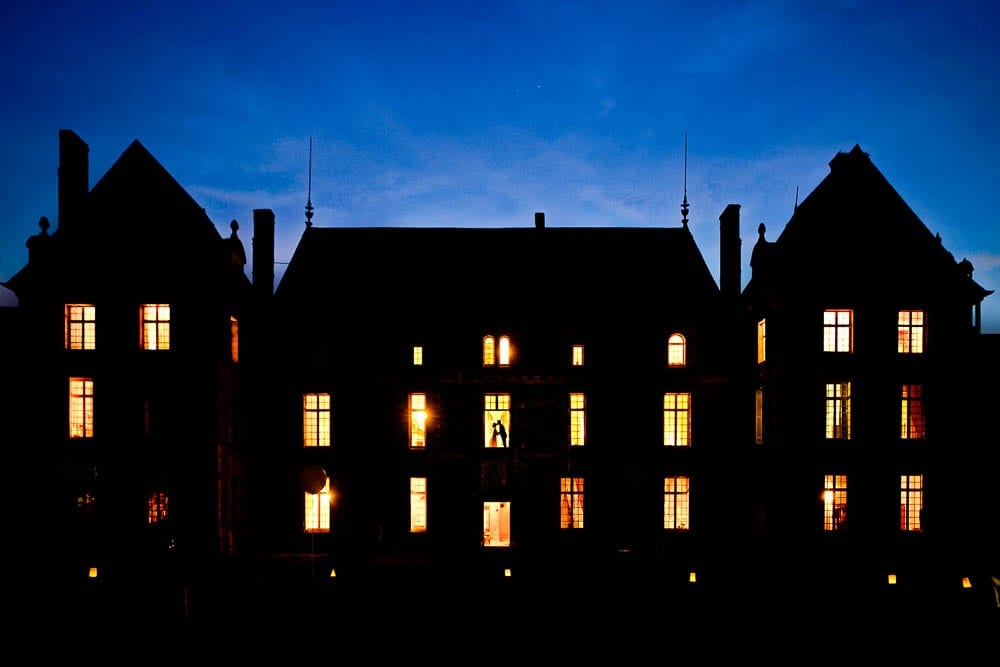 11 creative picture of bride and groom at the window of a french castle night picture
