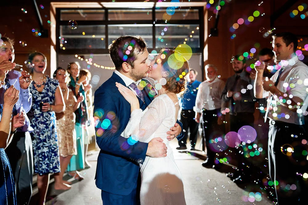 bride and groom grand exit creative picture with soap bubbles