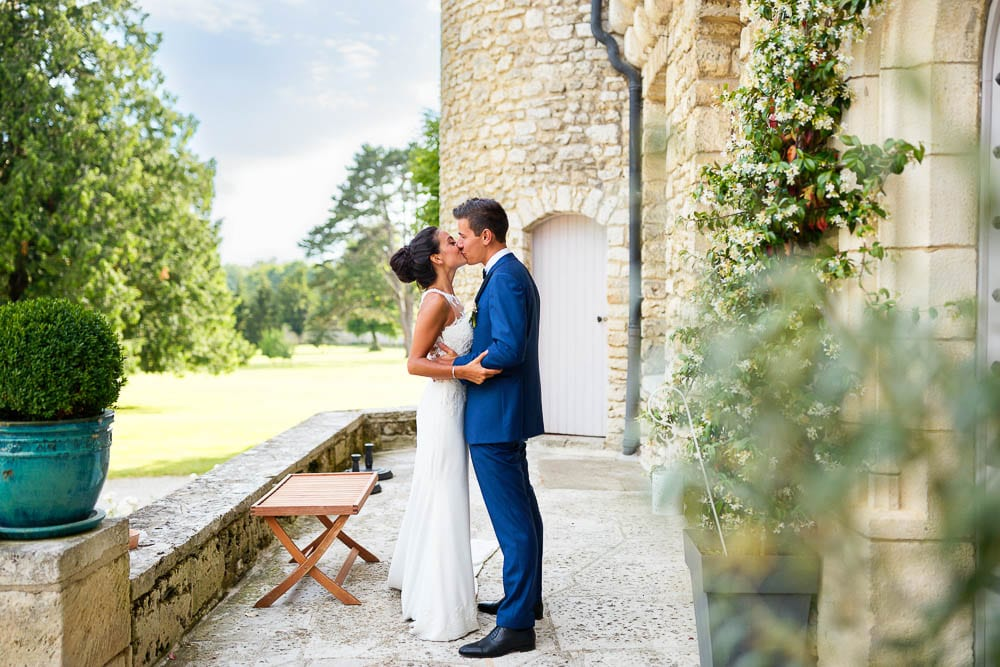 bride and groom kissing during cocktail hour at a castle