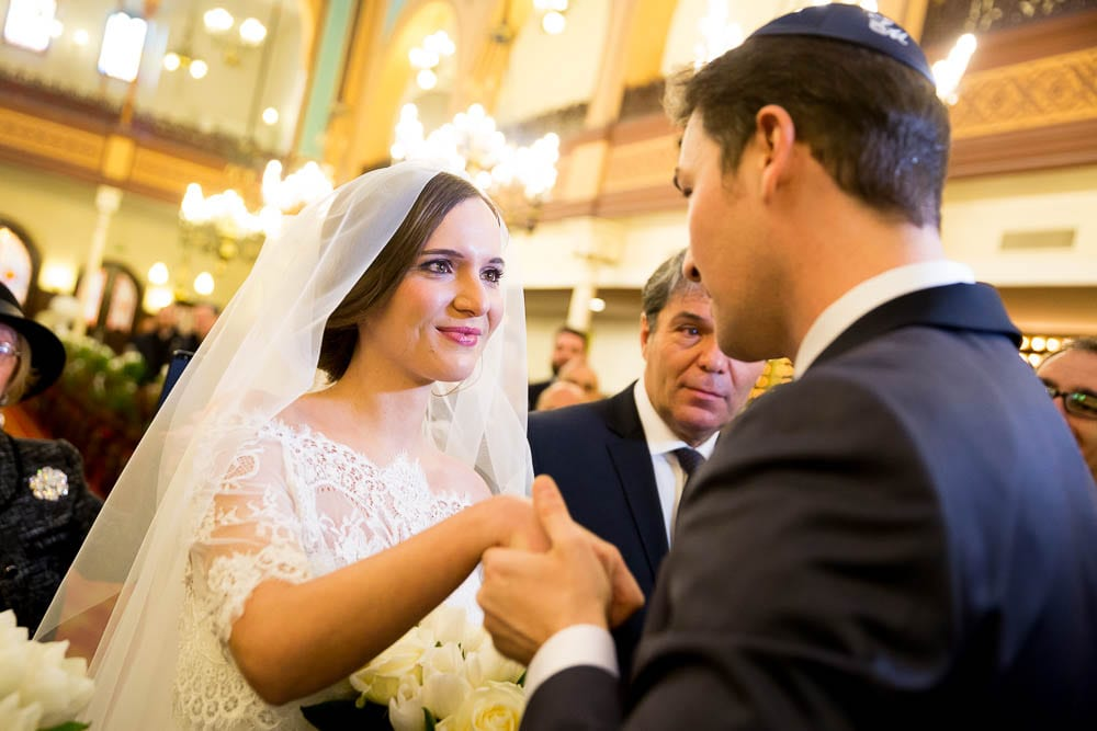 bride with tears in eyes when discover groom at jewish temple