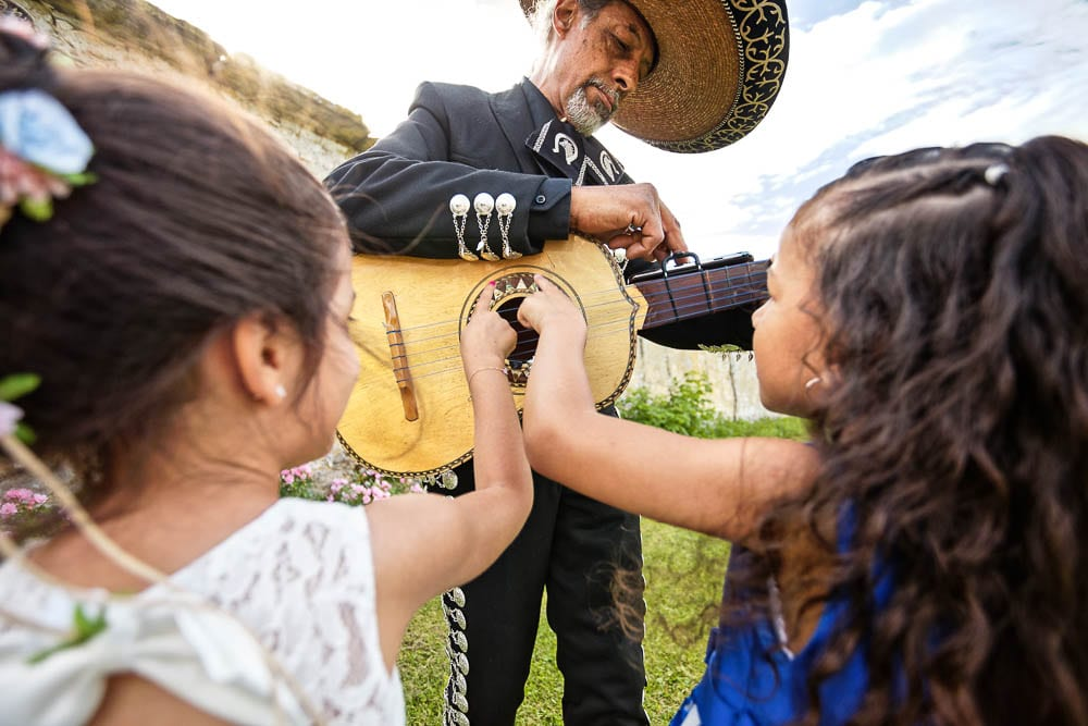 candid shoot of kids playing with mariachi during cocktail