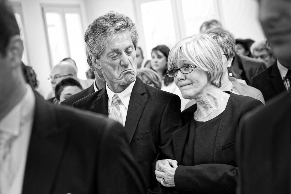 candid shot of parents during wedding ceremony black and white image
