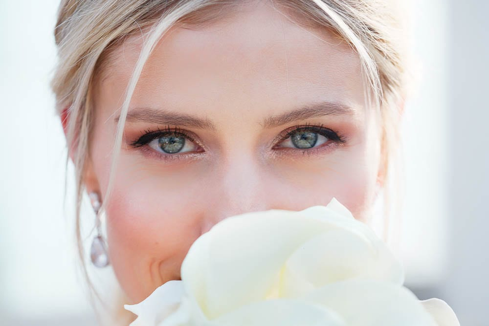 close up on blue eyes bride blond hair