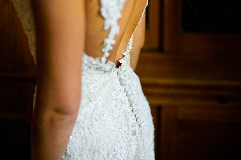 detail of the open back of brides wedding dress