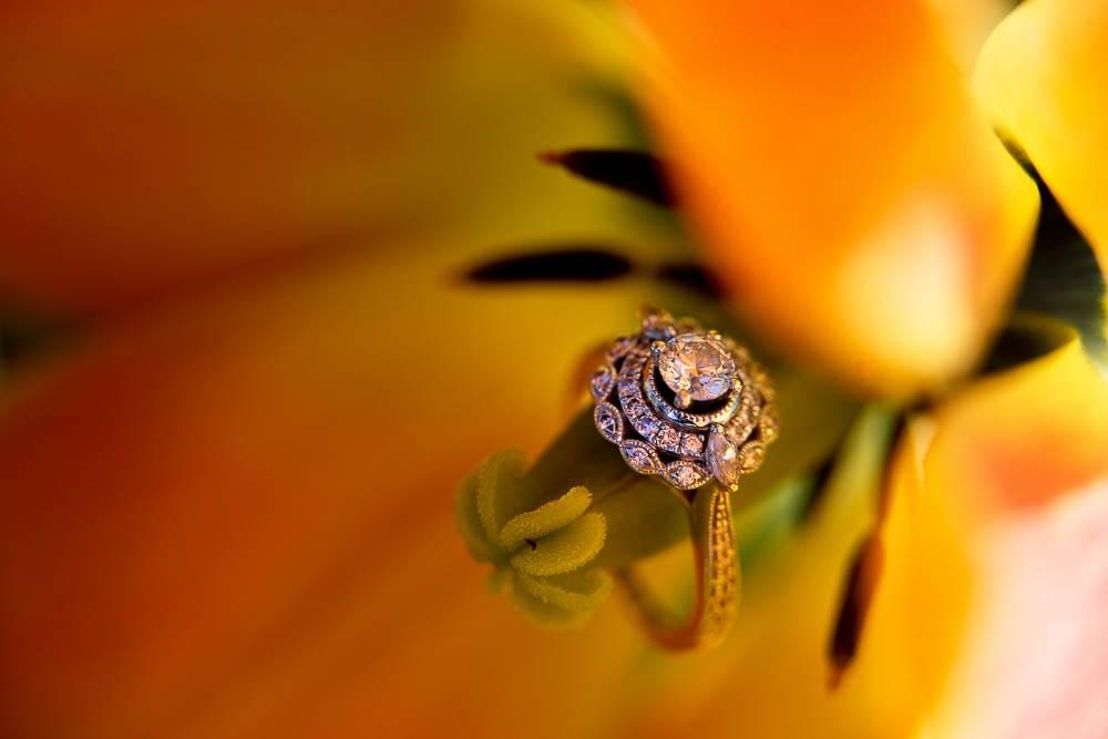 detail shot engagement ring on yellow tulip