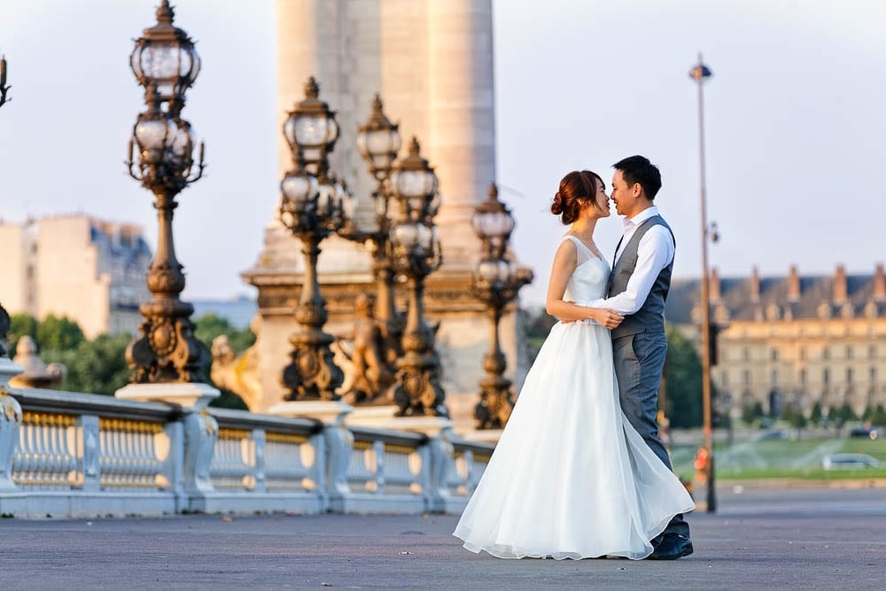Elopement photo of bride and groom at pont Alexandre III Paris morning light