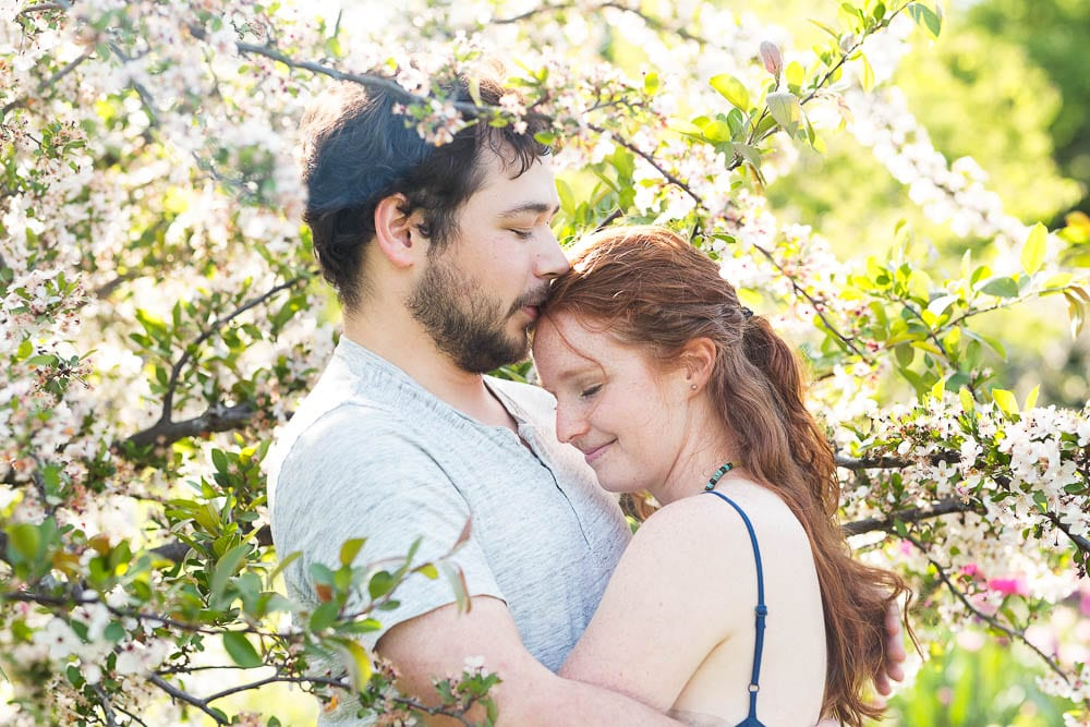 engagement session couple kissing with flowers