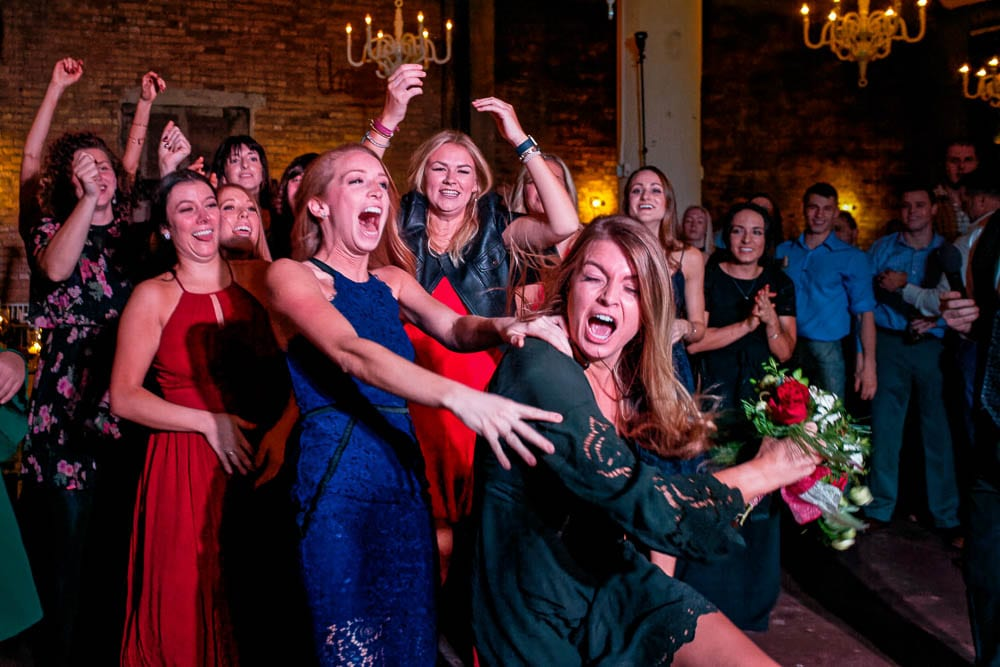 funny picture of girls catching the bouquet during bouquet toss