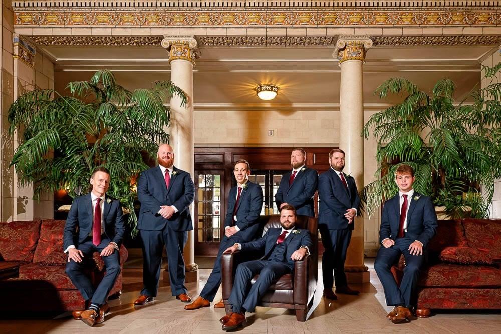 groom and groomsmen photo at historic wedding venue