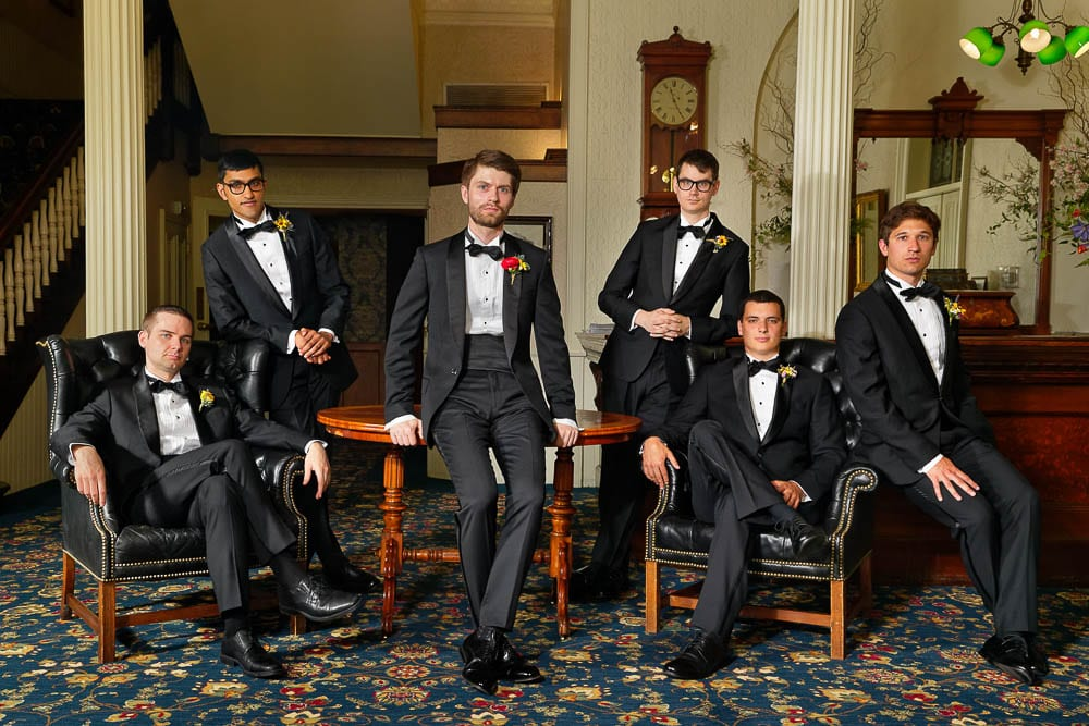 groom and groomsmen picture stage in historic hotel st james red wing