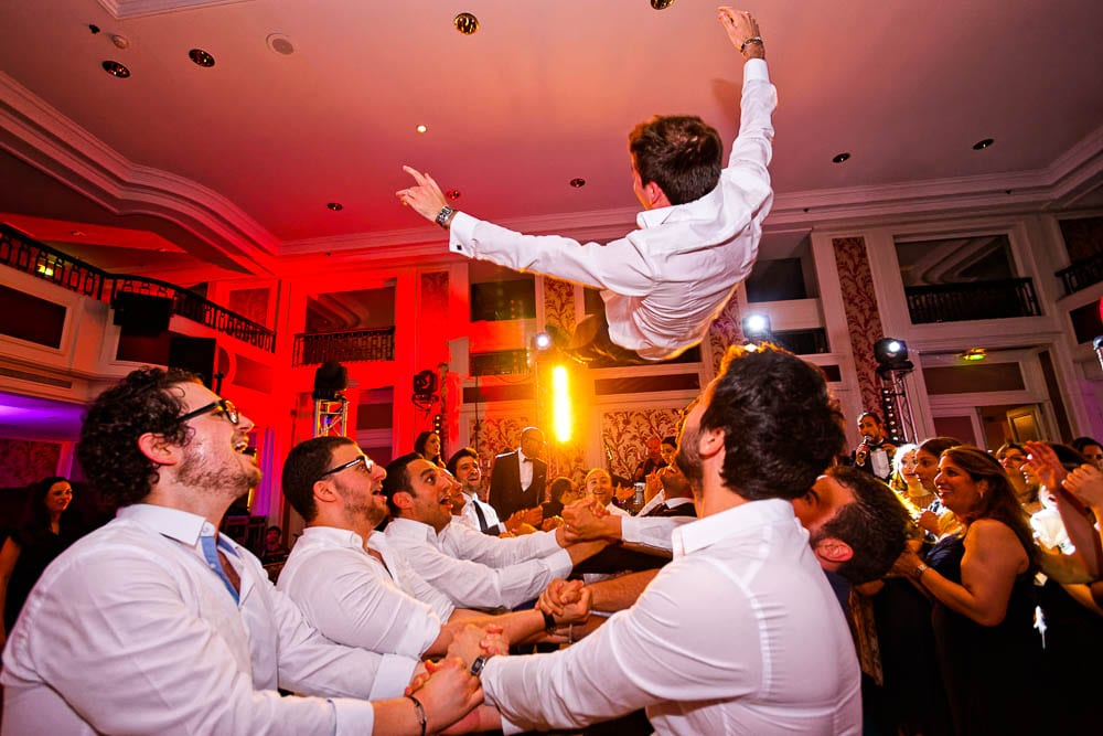 guest throwing groom in the air