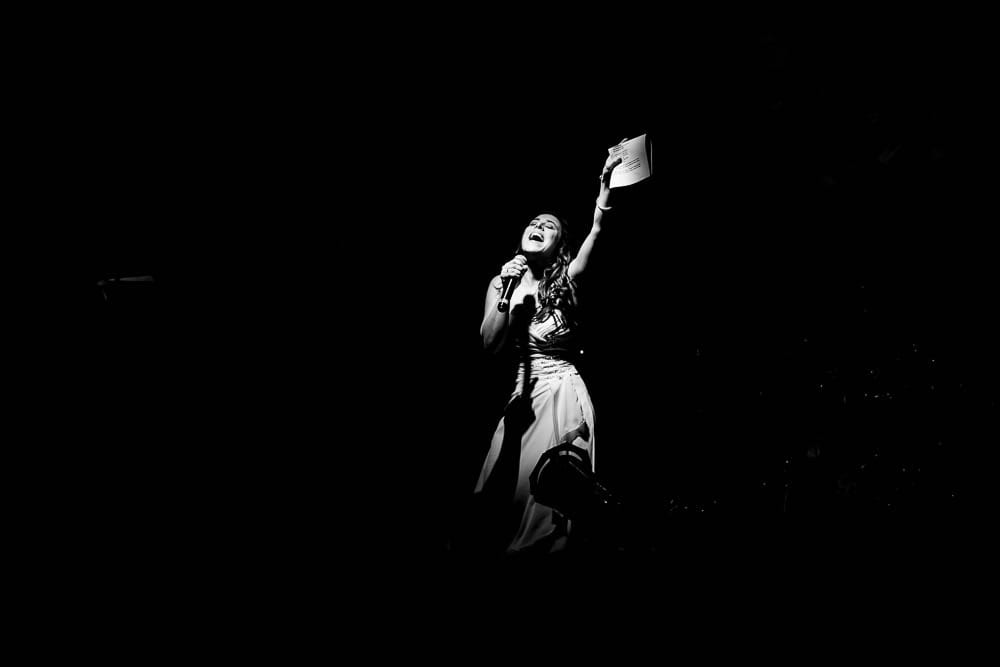 theatrale black and white picture of bride singing