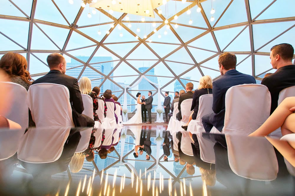 wedding ceremony at on a glass roof top with view on the city