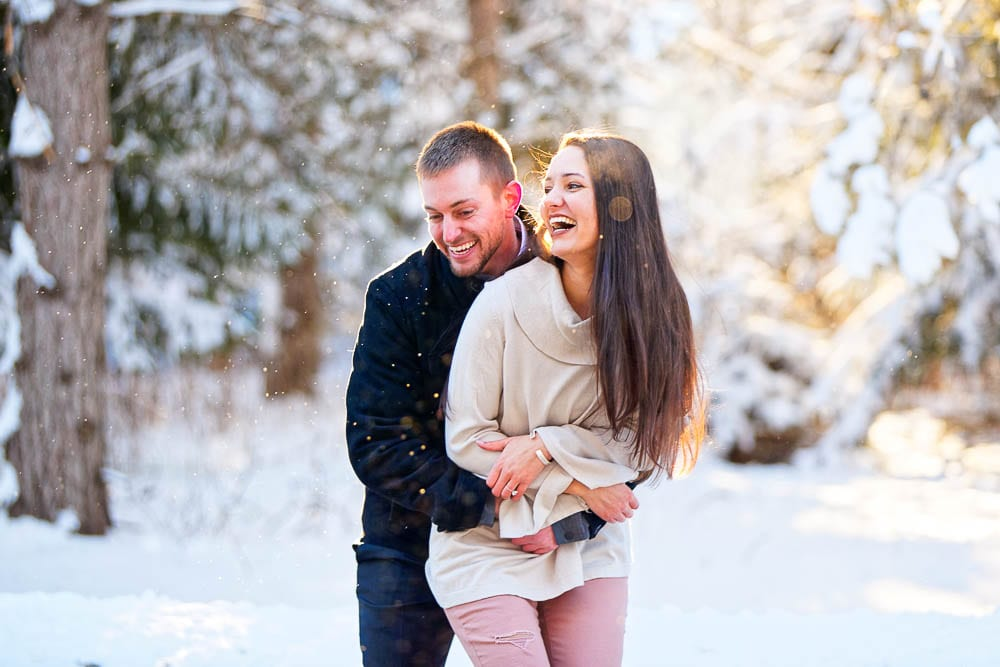 winter engagement session with snow and sun