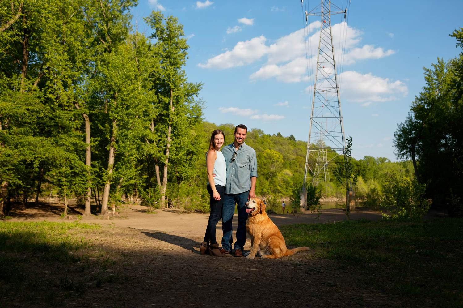 03 couple on trail with their dog at regional park minnehaha