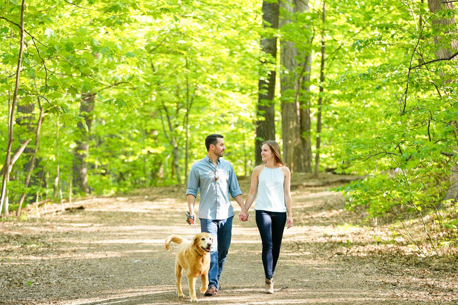 Minnehaha dog park couple with their pet walking on greenway