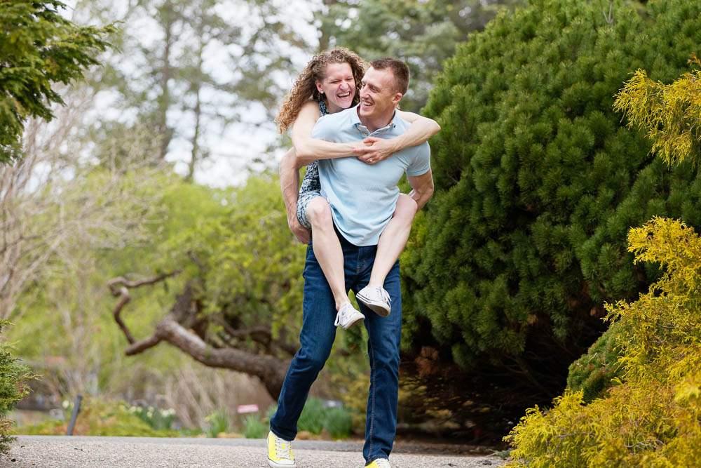 — couple do piggyback at minnesota landscape arboretum —
