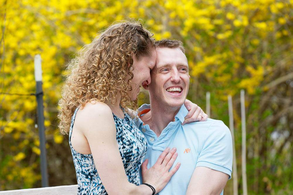— couple hugging with yellow flowers at minnesota landscape arboretum —