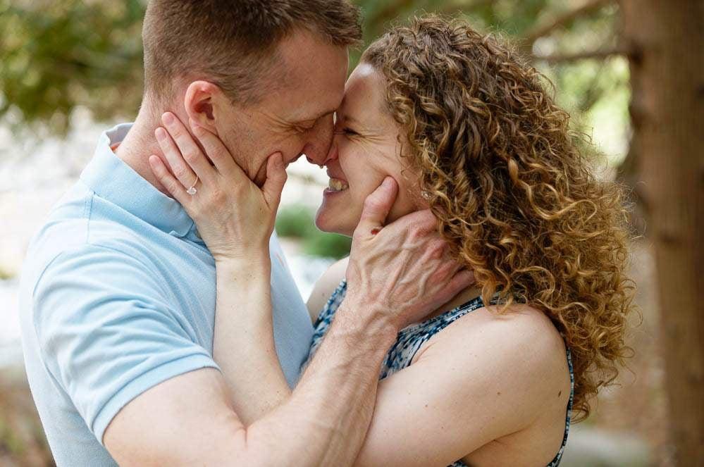— couple in love kissing at minnesota landscape arboretum —