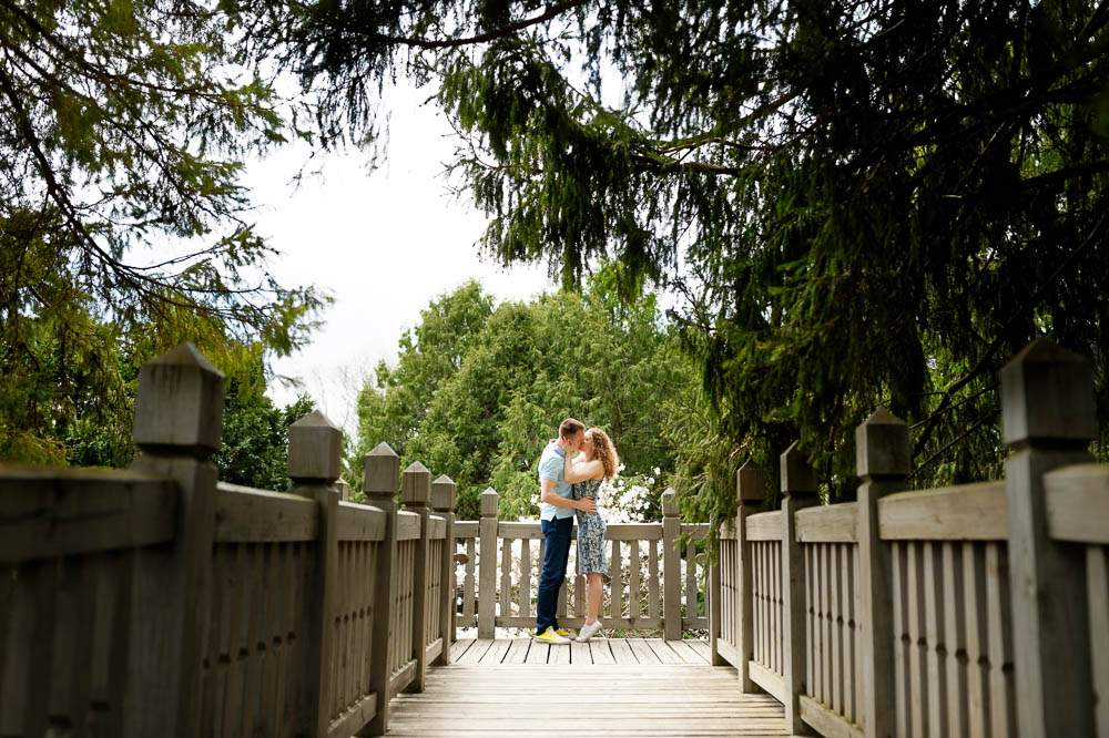 — Picture perfect of couple kissing on the wood aisle —
