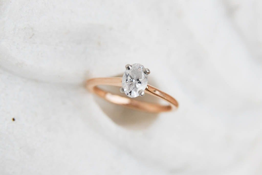 Diamond ring on white marble background