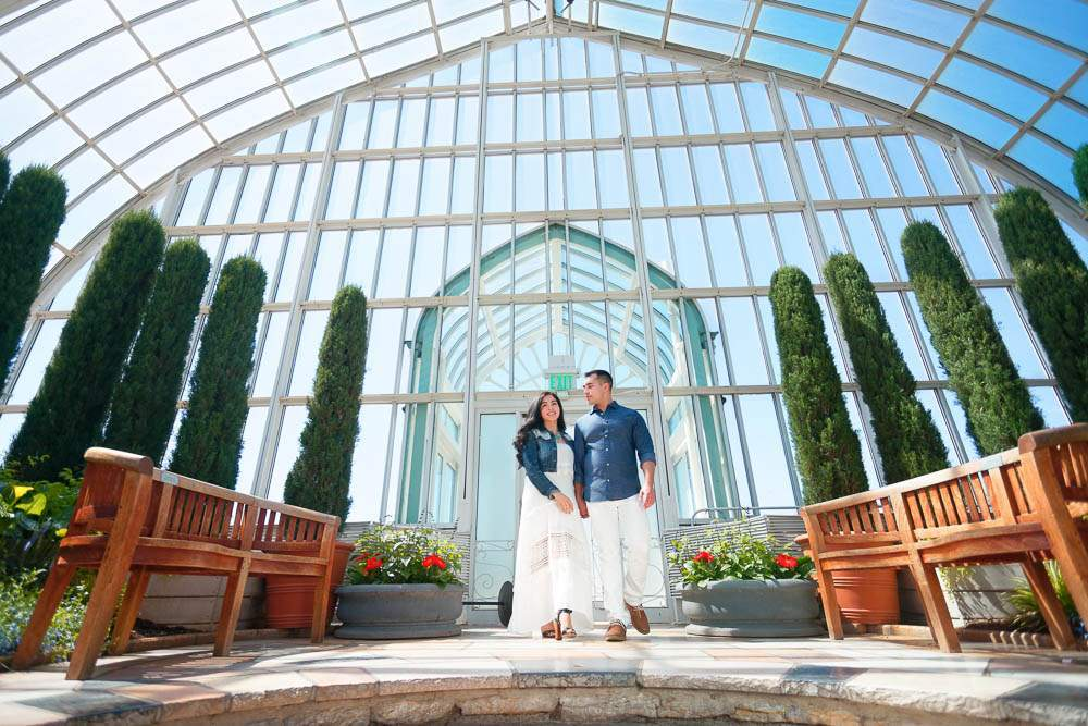 couple in green house with blue sky