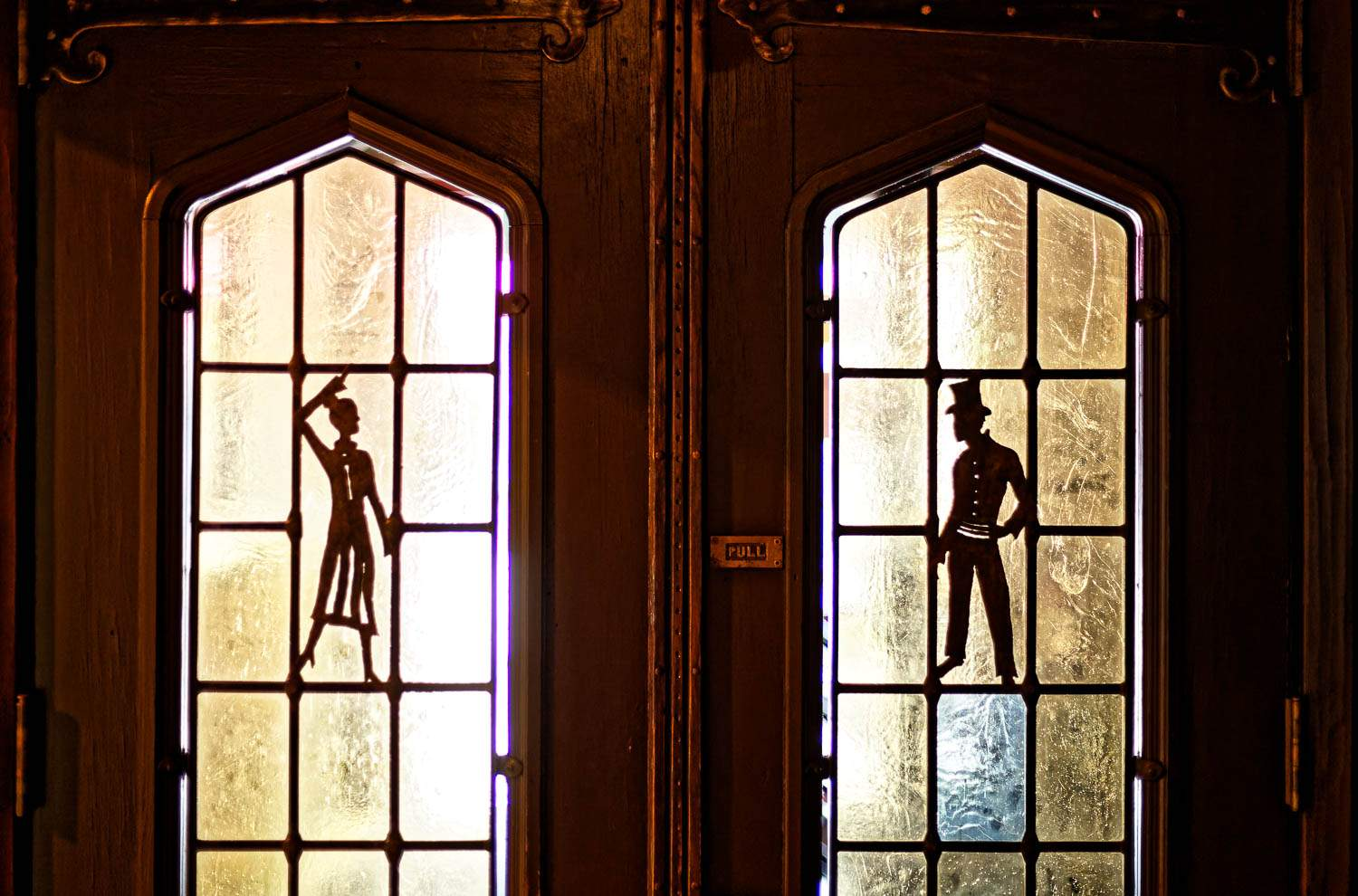 Silhouette of characters on the glass door