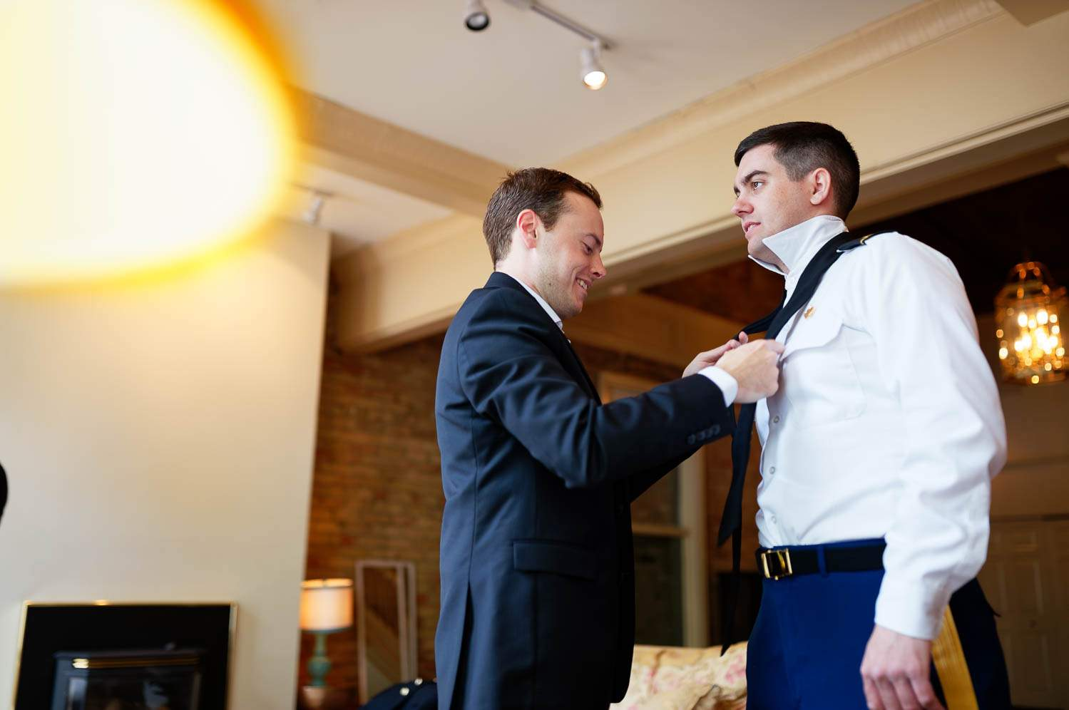 the best friend helping the groom