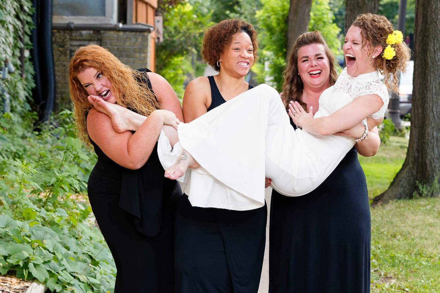 crazy bridal party carrying the bride