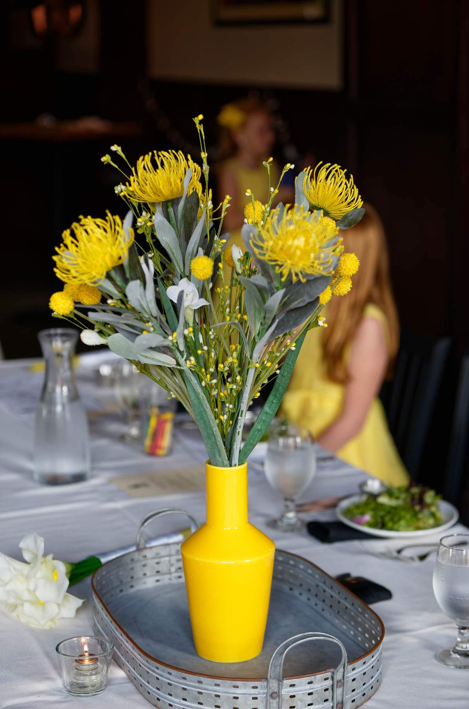 Yellow flowers in yellow vase