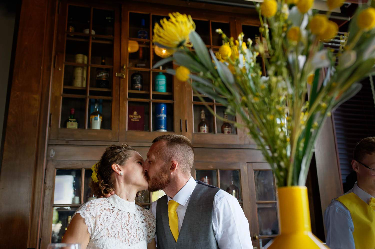 husband and wife kissing