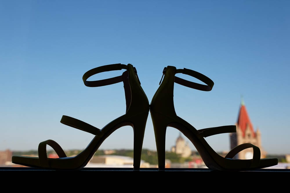 high heel shoes silhouette on blue sky