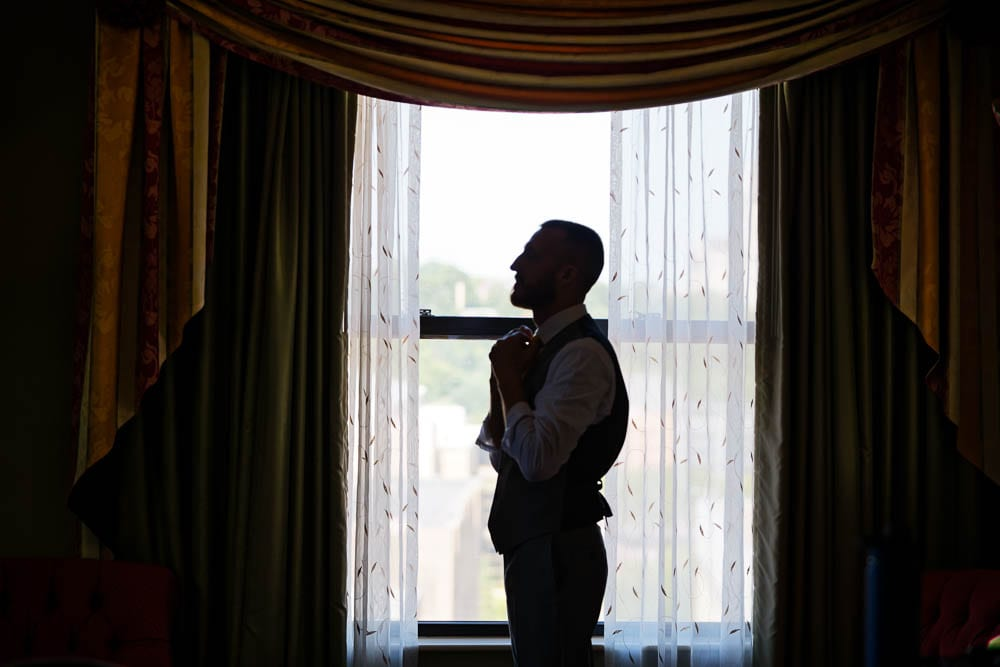 silhouette of the groom in front the window