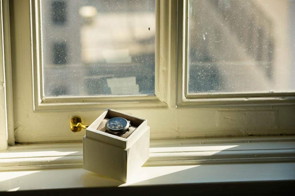 — michael kors watch on window —