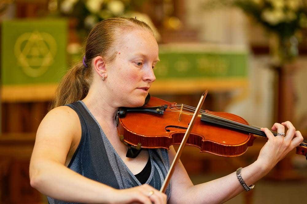 — woman playing violin —