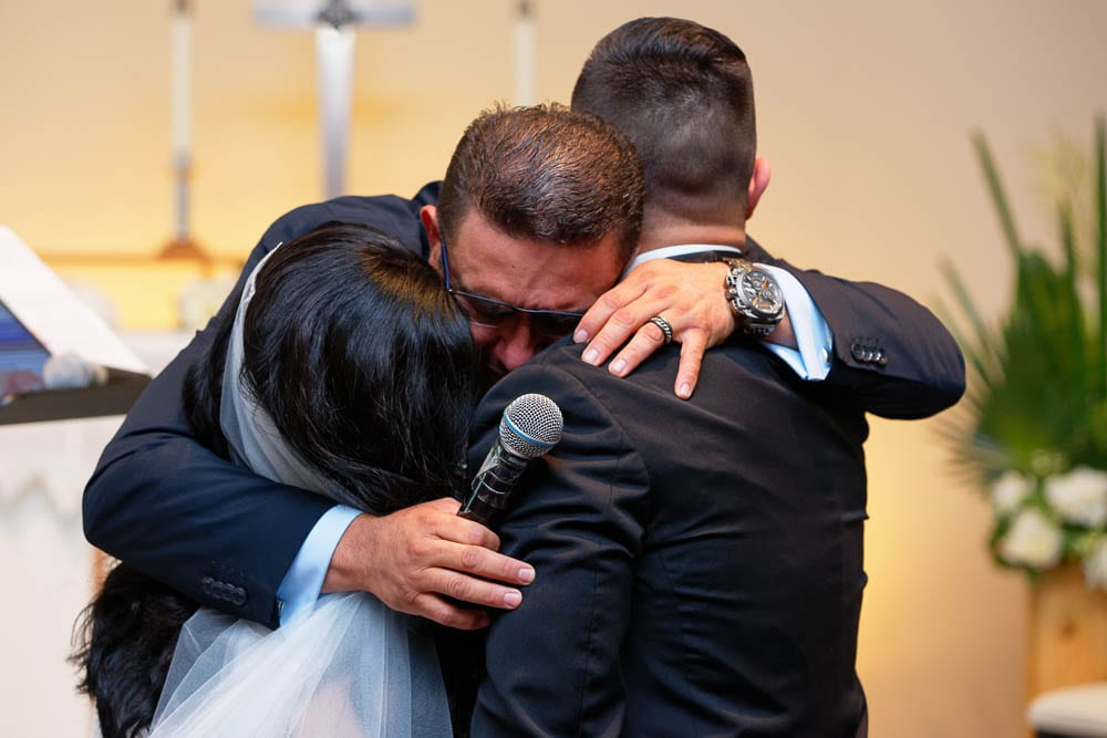 candid emotion shoot of father of the bride hugging