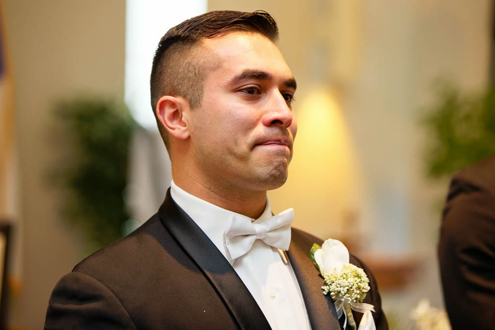 exquisite shot of groom with wet eye