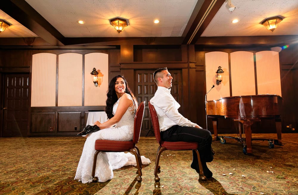 games during wedding reception with floor to ceiling oaks