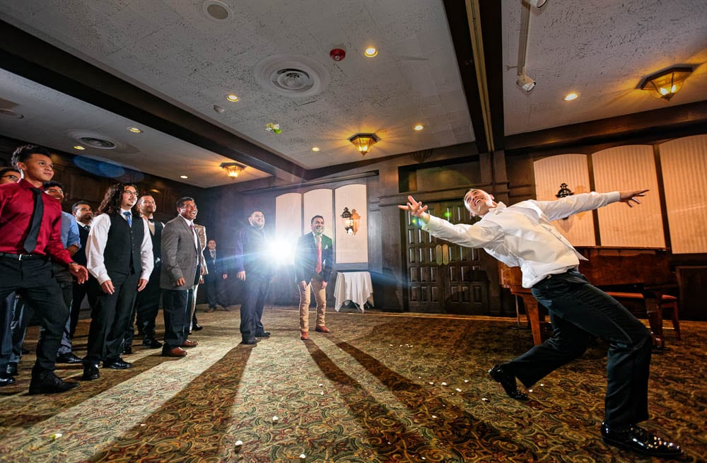 groom get married and have fun tossing boutonniere at renovated county club