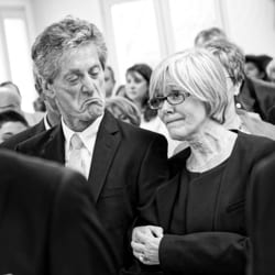 candid shot of parent's during wedding ceremony black and white image