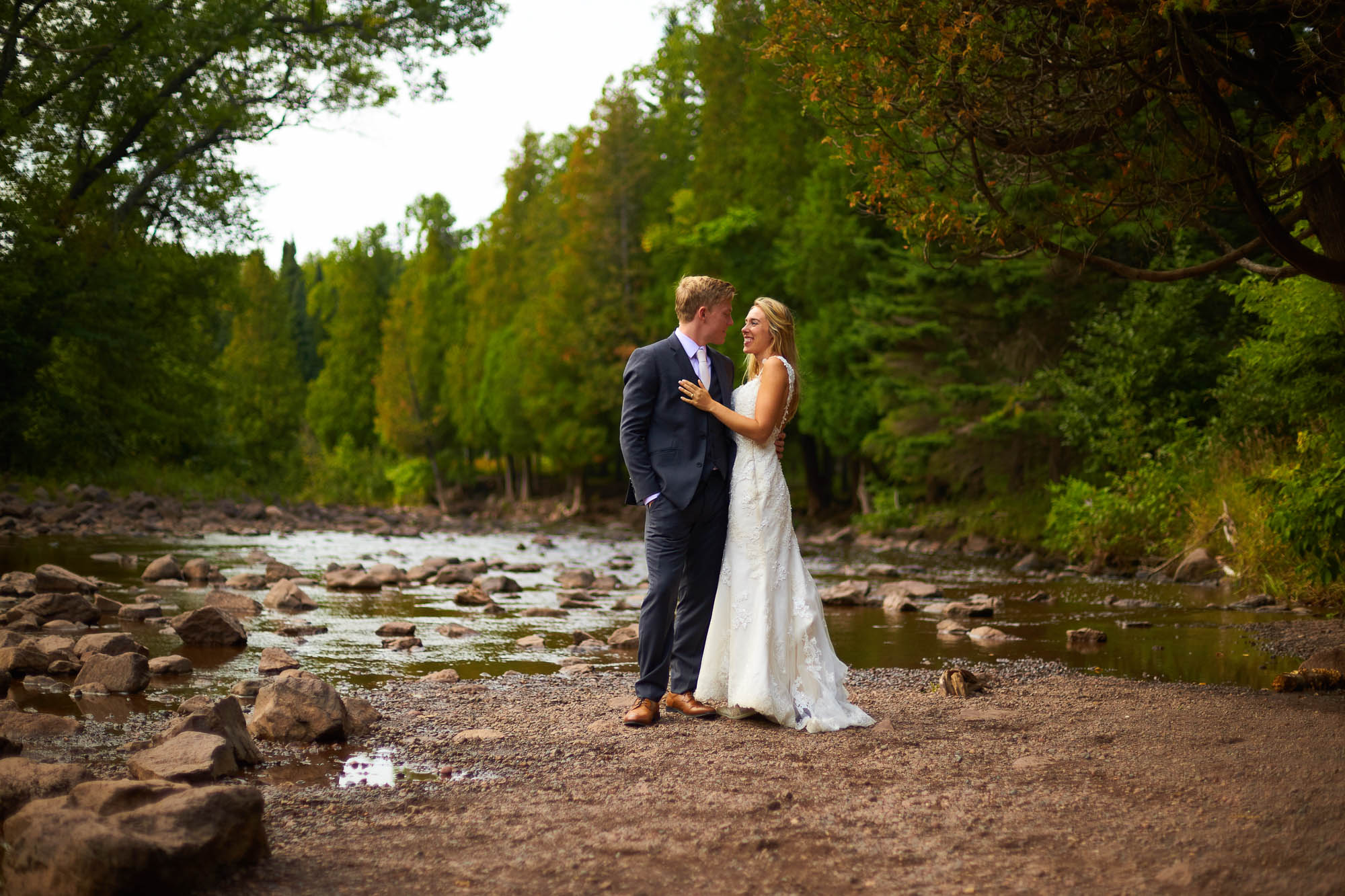 -bride-and-groom-in-front-of-the-river
