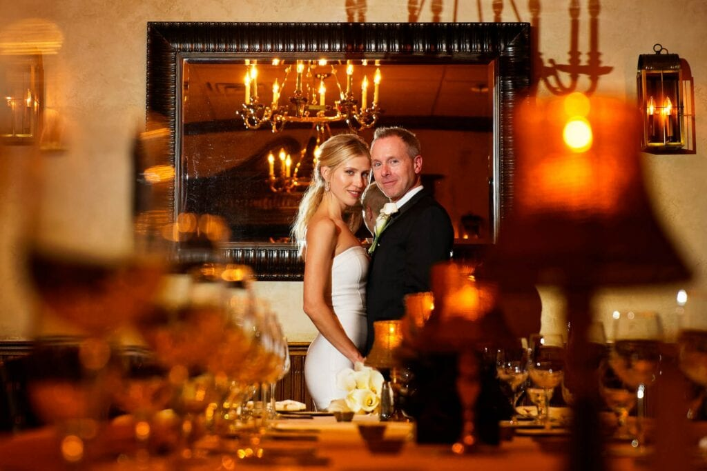 staged image of a bride and groom in a restaurant