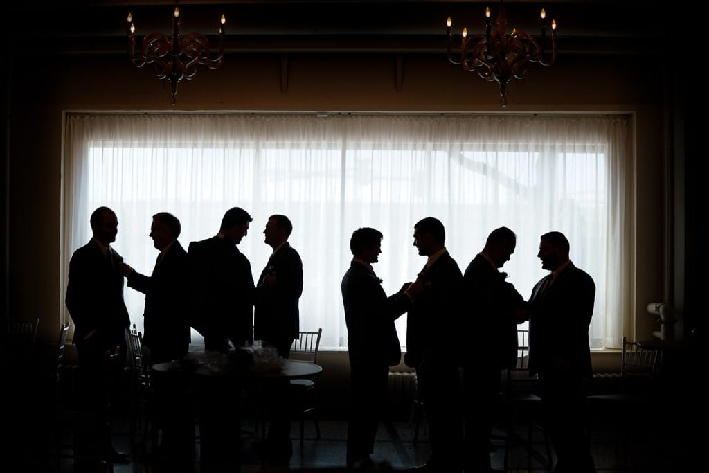 silhouette pictures of guys checking each other