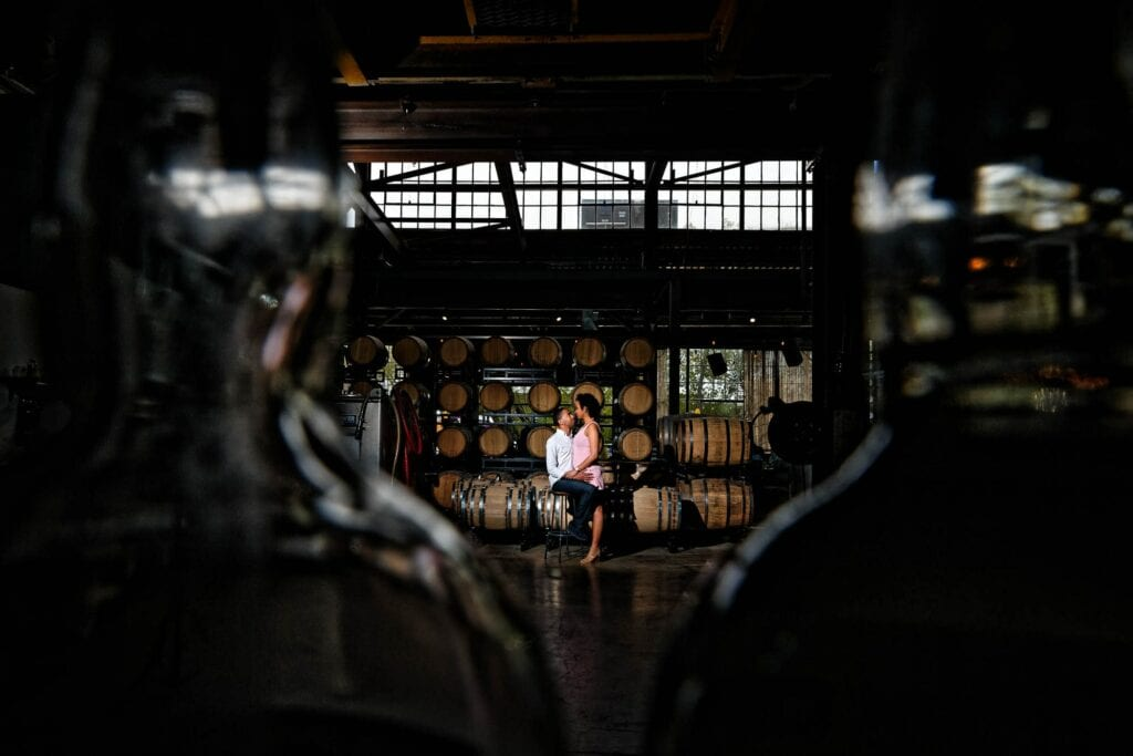 artistic engagagement photo in minneapolis brewery by their engagement photographer