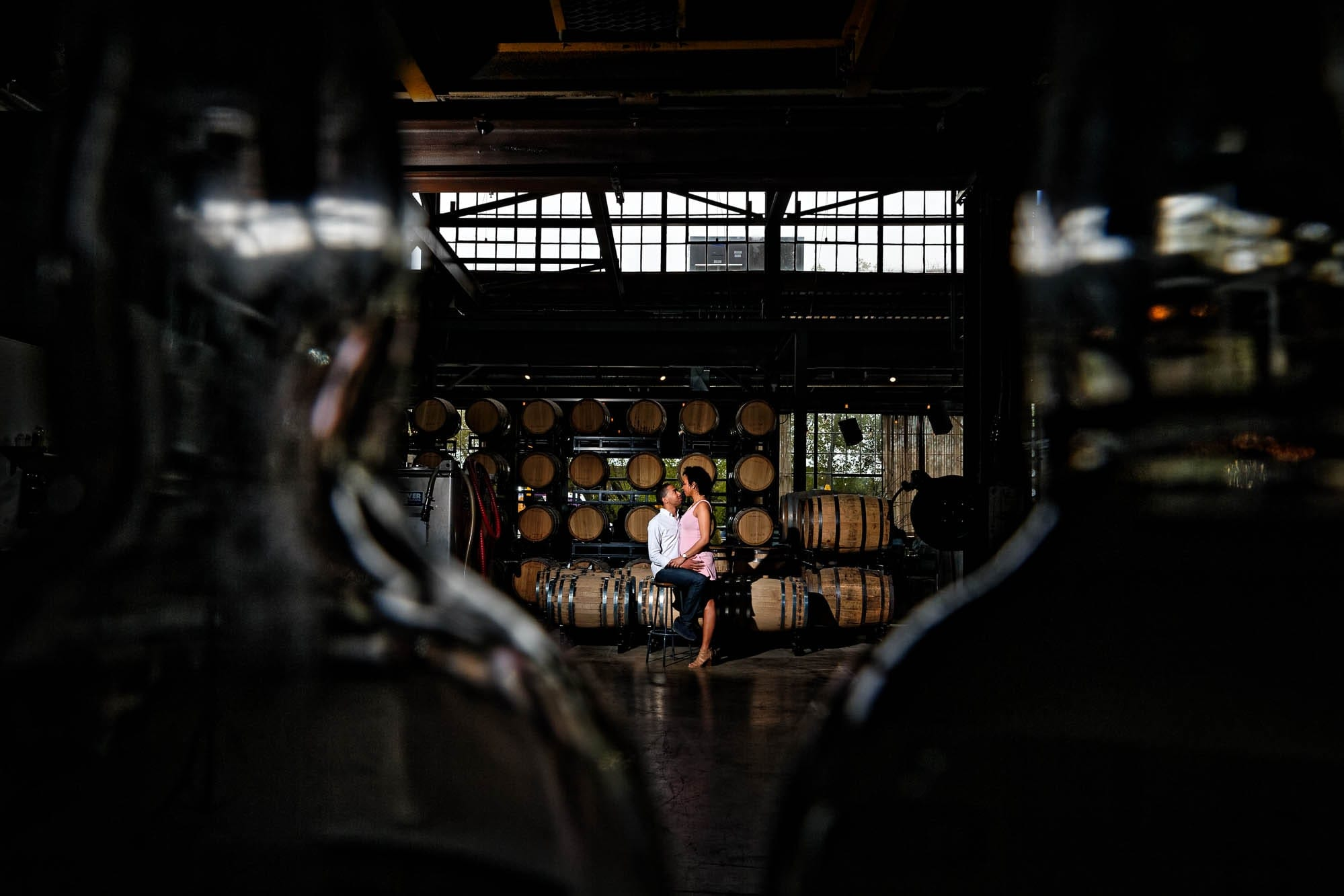 -artistic-engagagement-photo-in-Minneapolis-Brewery-by-their-engagement-photographer