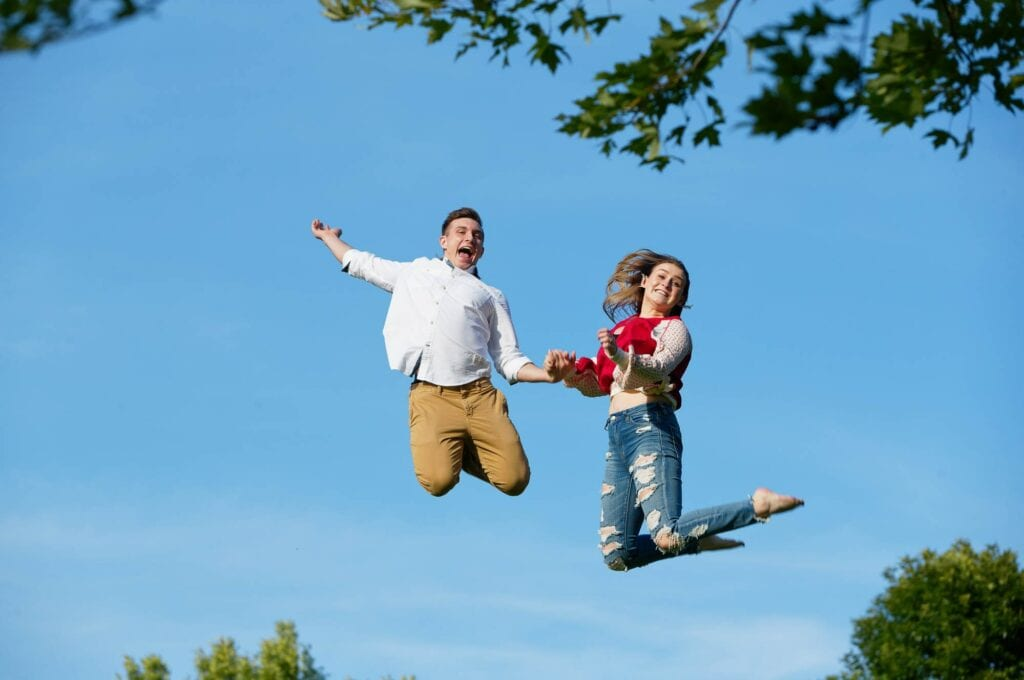 couple jumping in the sky